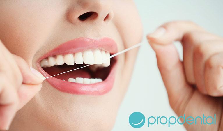 pasos buen uso del hilo dental